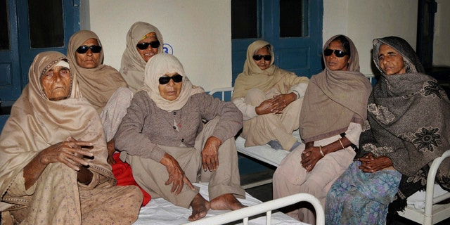 Indian elderly women who went blind following cataract surgeries performed at a free medical camp run by a charity sit together as they receive treatment at a hospital in Amritsar, India, Friday, Dec. 5, 2014. (AP Photo/Press Trust of India)