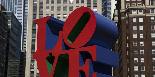 """The artist's """"LOVE"""" sculpture, in which the """"L″ and a leaning """"O″ sit atop the """"V″ and the """"E,"""" is instantly recognizable worldwide."""