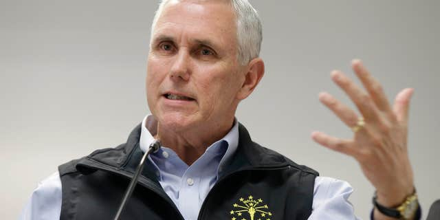 March 25, 2015: Indiana Gov. Mike Pence responds to a question during a news conference.