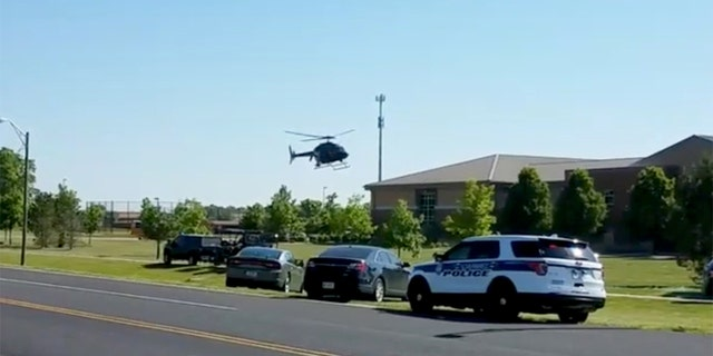 A helicopter lands near Noblesville West Middle School in Indiana.