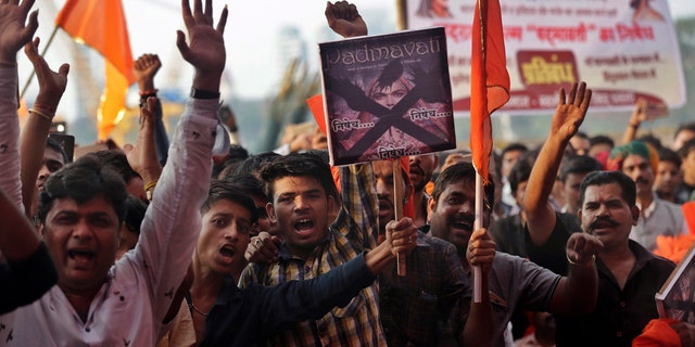 """Members of India's Rajput community shout slogans as they protest against the release of Bollywood film """"Padmavati"""" in Mumbai."""