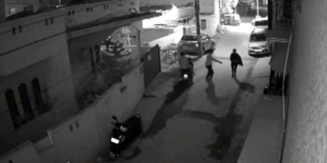 Jan. 1, 2017: This image taken from video shows two men on a scooter assaulting a woman in Bangalore, India