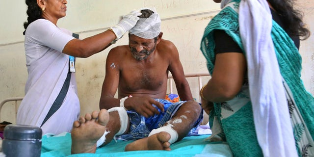 April 11: A victim grimaces in pain as he receives treatment at Kollam district hospital a day after he was injured after a massive fire broke out during a fireworks display at the Puttingal temple complex in Paravoor village, Kollam district, southern Kerala state, India.