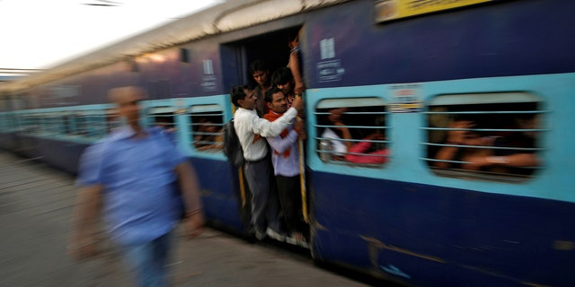 India's state-run railway has suspended seven workers after a train rolled backwards for seven miles after the brakes failed.