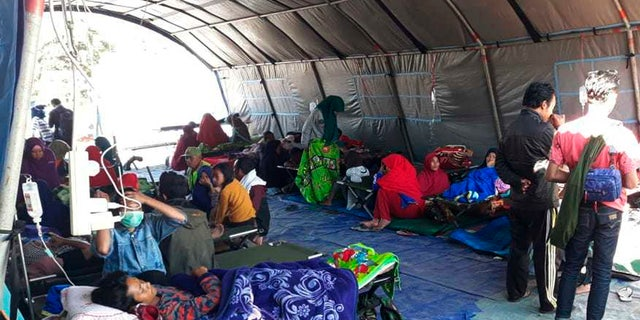 Earthquake survivors receive medical treatment at a temporary shelter in Sembalun, East Lombok, Indonesia.