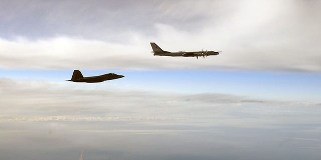An Air Force F-22 fighter jet intercepts one of the Russian Tu-95 bombers near Alaska on Tuesday.