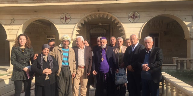 After Sunday Mass in the small Iraqi Christian town of Bahzani.
