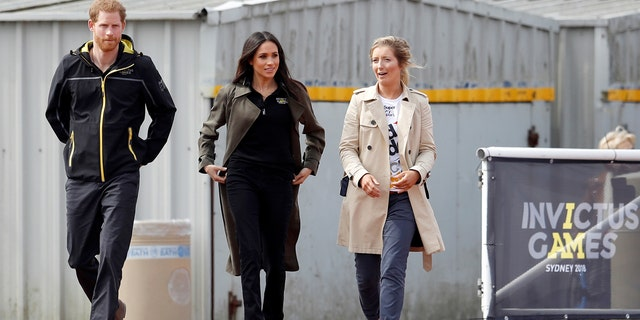 Prince Harry and Meghan Markle walk the track during the game trials.