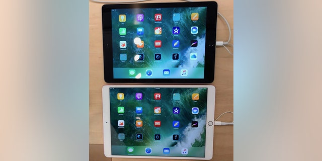 9.7-inch iPad Pro (black, top) and 10.5-inch iPad Pro (white, bottom). (Credit: Brooke Crothers)