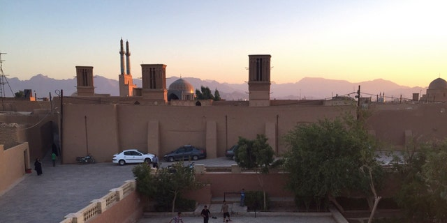 Iran Children playing soccer at sunset in Yazd, Iran