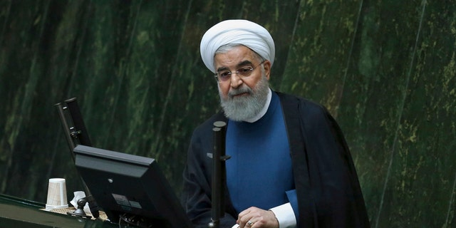 Iranian President Hassan Rouhani speaks in an open session of parliament, in Tehran, Iran, Sunday, Oct. 29, 2017.