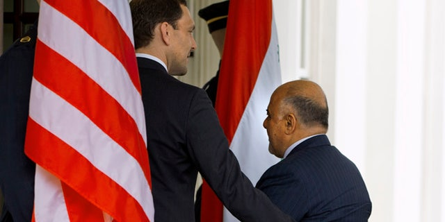 April 14, 2015: Iraqi Prime Minister Haider Al-Abadi is welcomed into the West Wing of the White House in Washington.