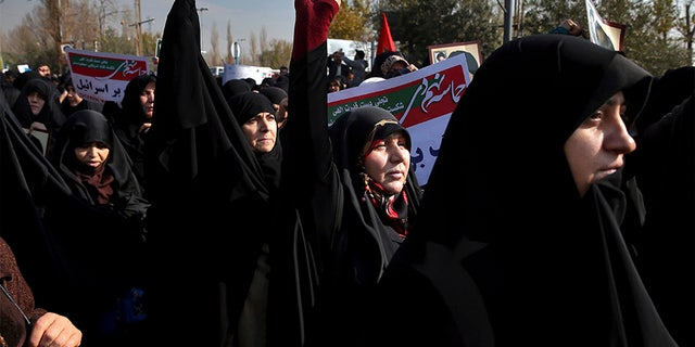 Iranian pro-government protesters chant slogans at a rally in Tehran, Iran, Saturday.