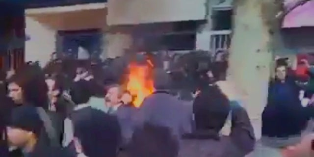 Protestors in Tehran, Iran come up against police as the uprising enters its seventh day.