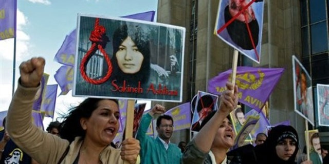 Aug 28, 2010:Supporters of National Council of Resistance of Iran in France, protest the death sentence of Sakineh Mohammadi Ashtiani, at Trocadero square in Paris. Ashtiani's sentence of death by stoning, which Iran has put on hold, has brought harsh condemnation from the U.S. , the European Union and rights groups who are demanding Tehran stay the execution.