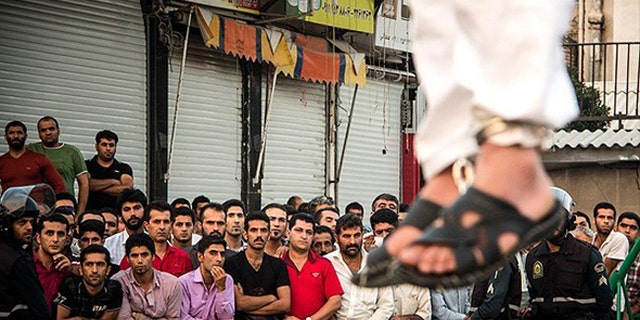 Public executions in Iran are often witnessed by children and are meted out for offenses such as homosexuality and drug possession. (Courtesy: Iran Human Rights)