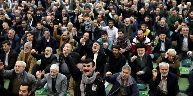 Iranians are seen chanting slogans during prayers in Tehran. The country was hit by several days of widespread protests.