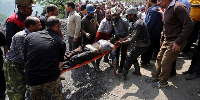 In this picture released by the Tasnim News Agency, miners and rescue personnel carry an injured mine worker after a coal mine explosion, near Azadshahr in northern Iran, Wednesday, May, 3, 2017.