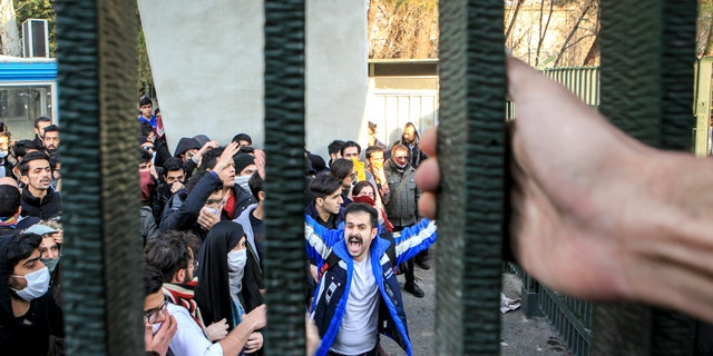 In this Dec. 30, 2017 file photo, taken by an individual not employed by the Associated Press and obtained by the AP outside Iran, university students attend an anti-government protest inside Tehran University, in Tehran, Iran. (AP Photo, File)