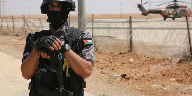 A Jordanian soldier stands guard the Iraq-Jordan border on Aug. 30, 2017.