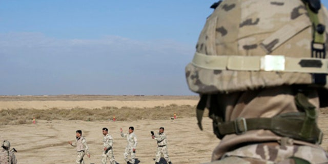 Nineveh police forces train with coalition partners southeast of Baghdad.