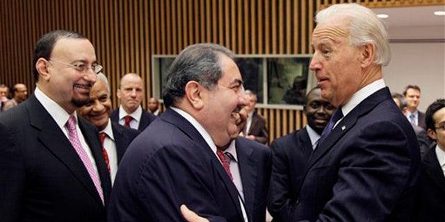Dec. 15, 2010: U.S. Vice President Joe Biden, right, greets Iraqi Foreign Minister Hoshyar Zebari, center, before a meeting of the United Nations Security Council. At left is Hamid al-Bayati, Iraq's U.N. ambassador.