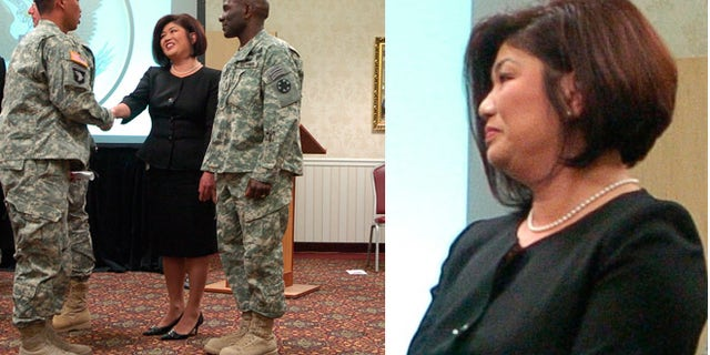 Irene Martin, the US Citizenship and Immigration Services field boss who clashed with federal law enforcement agents, is shown here in file photo greeting Spc. Brent Kiley, of the US Army's 11th Armored Cavalry Regiment.