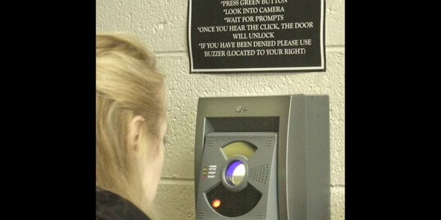 An iris-recognition scanner is used to gain entrance to a New Egypt, N.J., elementary school in 2003.