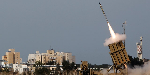 Nov. 16, 2012: An Israeli Iron Dome launcher fires an interceptor rocket to counter an Hamas strike in the southern city of Ashdod.