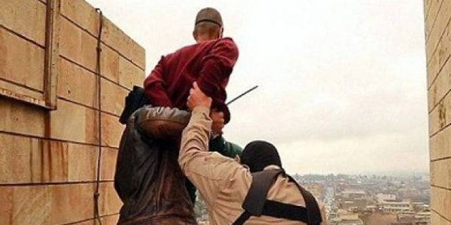 ISIS militants are seen throwing a suspected gay man off of a rooftop.