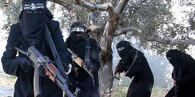 A brigade of women enforce Sharia law in the Islamic State stronghold of Raqqa. (Reuters)