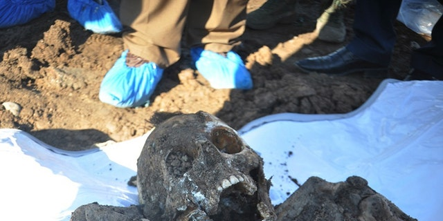This photo shows a skeleton exhumed from a mass grave containing Yazidis killed by ISIS militants in the Sinjar region of northern Iraq.