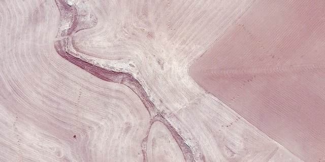 This satellite image shows a suspected mass grave site next to a ravine at Badoush Prison in Mosul, Iraq, on July 17, 2014.