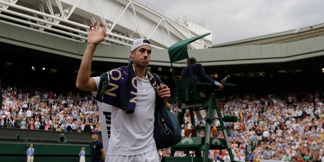 John Isner of the U.S. leaves the court after being defeated by Kevin Anderson of South Africa in the men's semifinal match at  Wimbledon on Friday. It was a marathon game.
