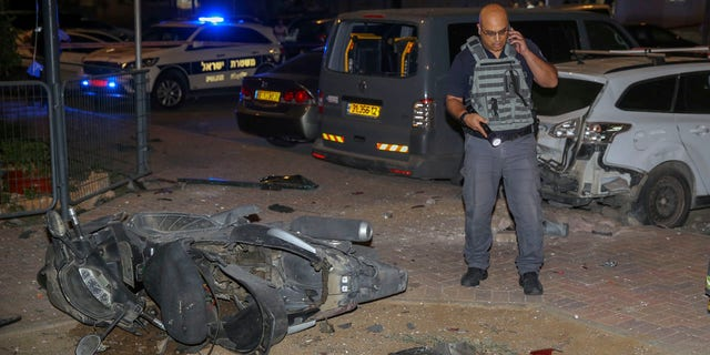 A security officer standing near the site of a rocket strike in Sderot, Israel, on Wednesday.