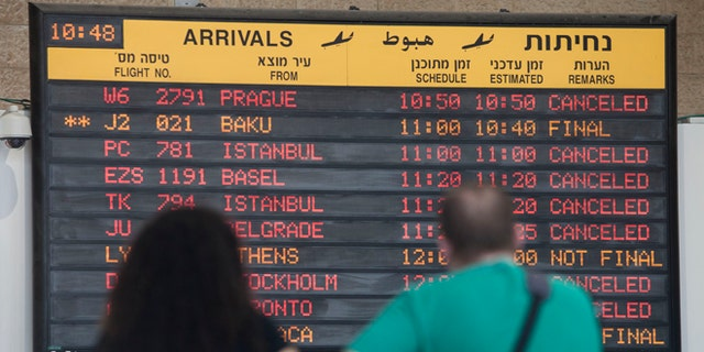 July 23, 2014: A arrivals flight board displays various canceled and delayed flights in Ben Gurion International airport a day after the U.S. Federal Aviation Administration imposed a 24-hour restriction on flights after a Hamas rocket landed Tuesday within a mile of the airport, in Tel Aviv, Israel.