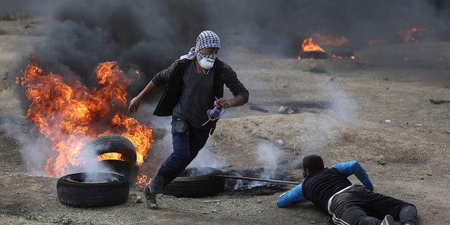 Protesters lit tires on fire and threw incendiary projectiles to protest as the US officials opened its new embassy in Jerusalem.