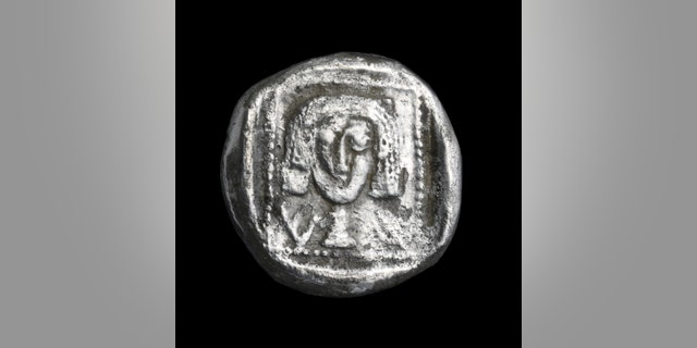 Rare silver coin from the 4th century BCE, one of the most ancient ever discovered in the Jerusalem area. (Photo: Clara Amit, Israel Antiquities Authority)