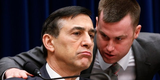 FILE: Chairman of the House Oversight and Government Reform Committee Rep. Darrell Issa listens to his staff member during the Committee hearing.