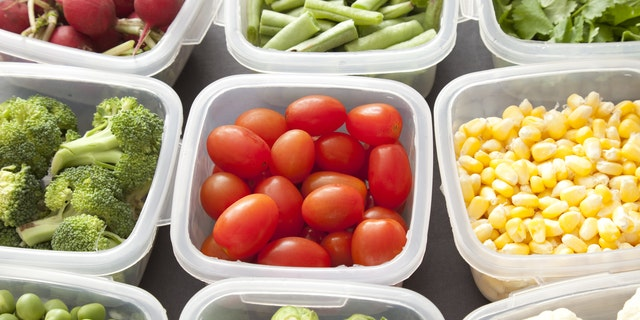 Different types of veggies each in a platic container