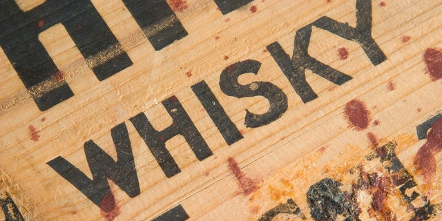 Closeup detail of an antique whiskey box with gunk. Sharp. Processed RAW.