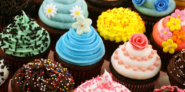 The teen spent $54 on cupcakes after another customer allegedly made offensive comments.