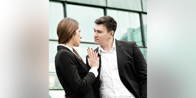 Sexual harassment at work - manager in aggressive stance towards younger female coleague