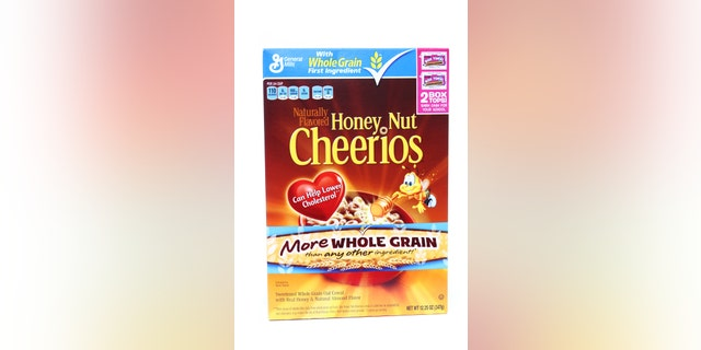 West Palm Beach, USA - December 24, 2011: This is a studio shot of a box of Honey Nut Cheerios. Cheerios are a popular American breakfast cereal made from oats and  manufactured by General Mills.