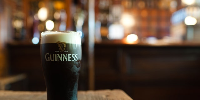 Dublin, Ireland - November 17, 2011: A pint of Guinness in traditional Irish pub.