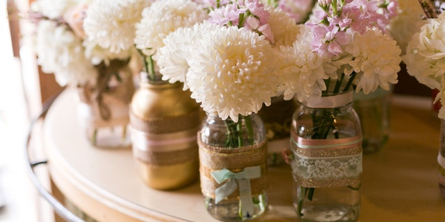 DIY flower arrangements like simple mason jars or even flowerless centerpieces will be way cheaper than a florist.
