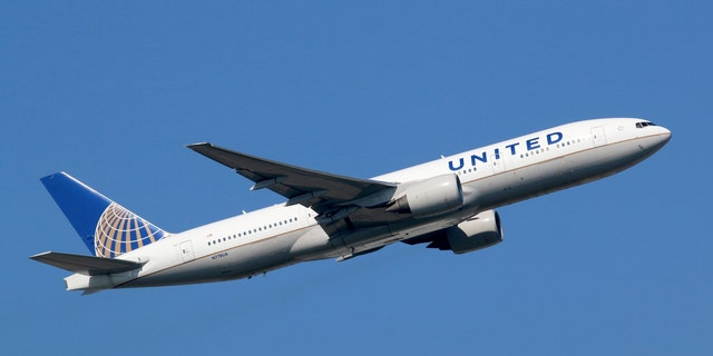 """A United Airlines flight was forced to turn back after a passenger """"initiated an altercation"""" with a crew member."""