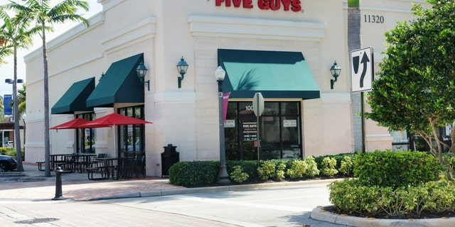 Palm Beach Gardens, USA - June 8, 2015:  Five Guys retail hamburger and fries restaurant in a shopping mall in Palm Beach Gardens, Florida. Five Guys is an American chain of  fast food restaurants that specializes in custom ordered hamburgers, hot dogs, and French fries.