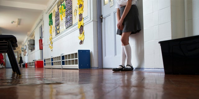 Student gets pulled out of class for dress code infraction.