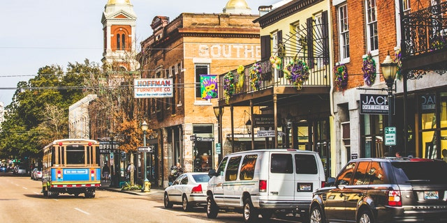 Mobile, Alabama, USA - February 24, 2014: Empty Dauphin street in historic district is ready for Mardi Gras celebrations in the evening.
